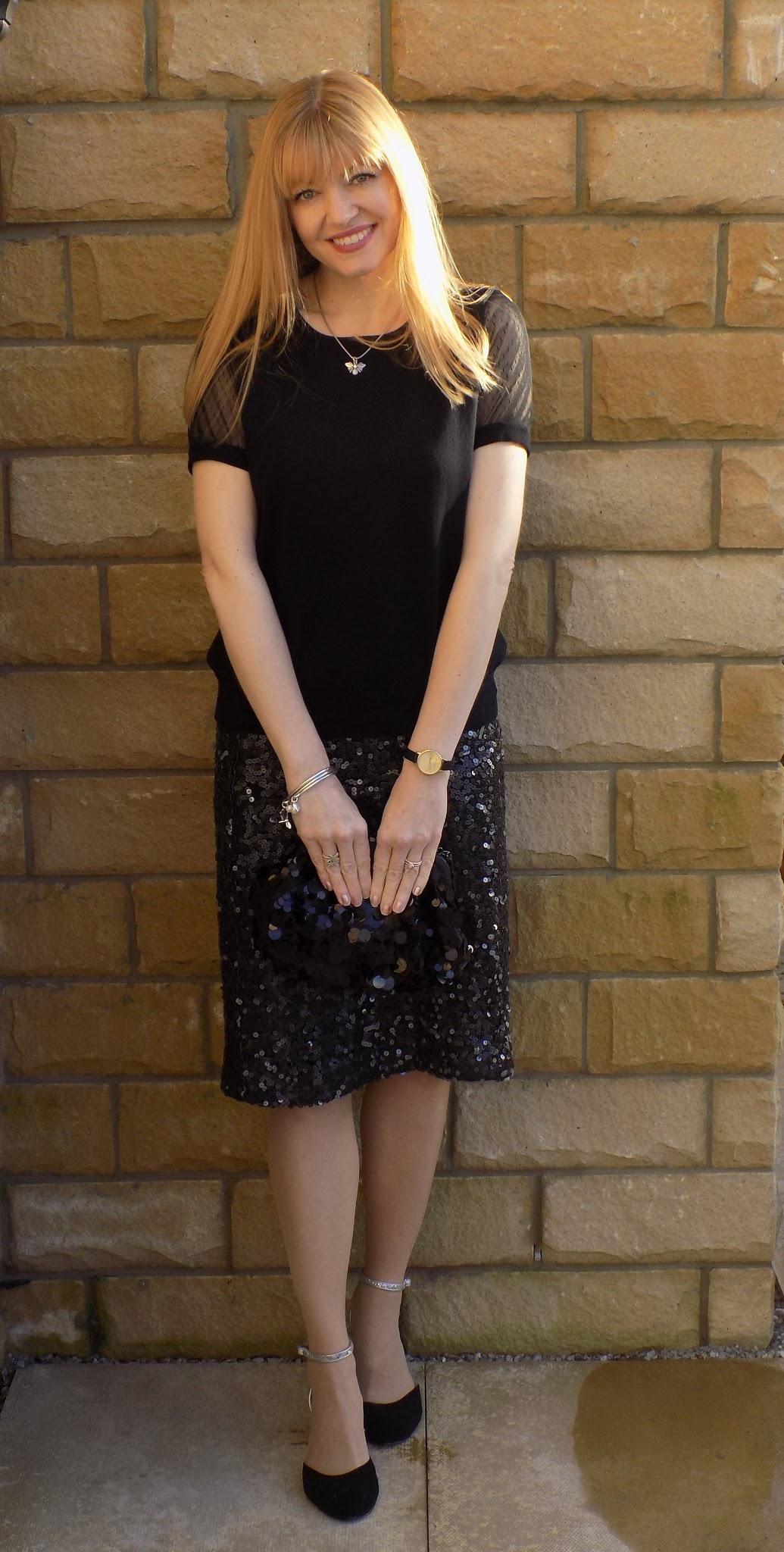 black sheer-sleeved top with gunmetal grey sequinned skirt