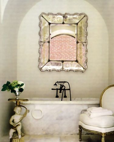 Elegant French bathroom with stone bathtub by Eleanor Cummings