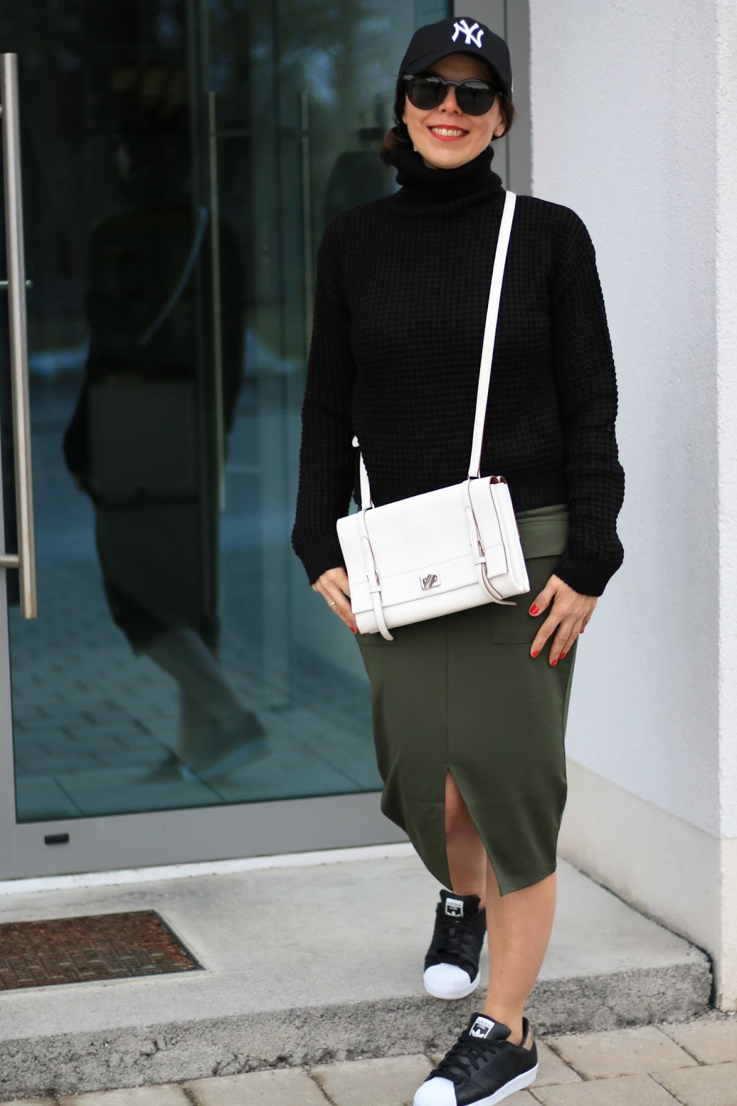 Freetime look, black turtle neck, white Prada bag, khaki midi skirt, black Adidas sneakers with pyhton