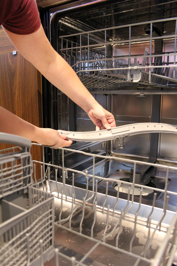 Remove and clean dishwasher stray arm