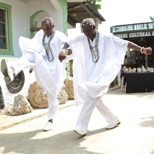 Kehinde and Taiwo dancing hand in hand