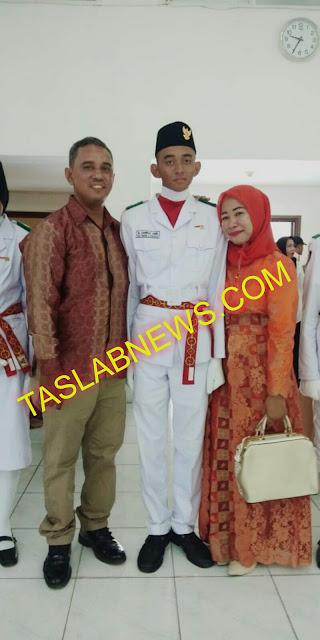 Mhd Sahriza Amri anggota Paskibra Asahan 2018 dan kedua orangtuanya  Siska Iswanti alumni SMA Negeri 2 Kisaran tahun 1997 dan Aiptu Safrizal Amri anggota Polres Asahan.