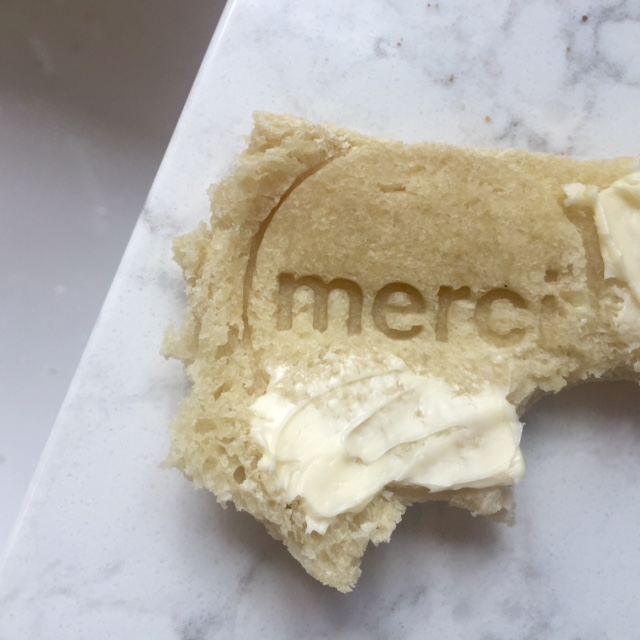 "Sourdough bread stamped with ""merci"" by Hello Lovely Studio. #gratitude #hellolovelystudio #bread"