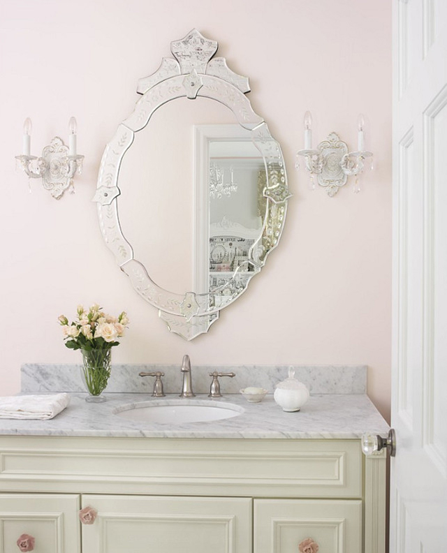 Blush pink bathroom with glam touches.