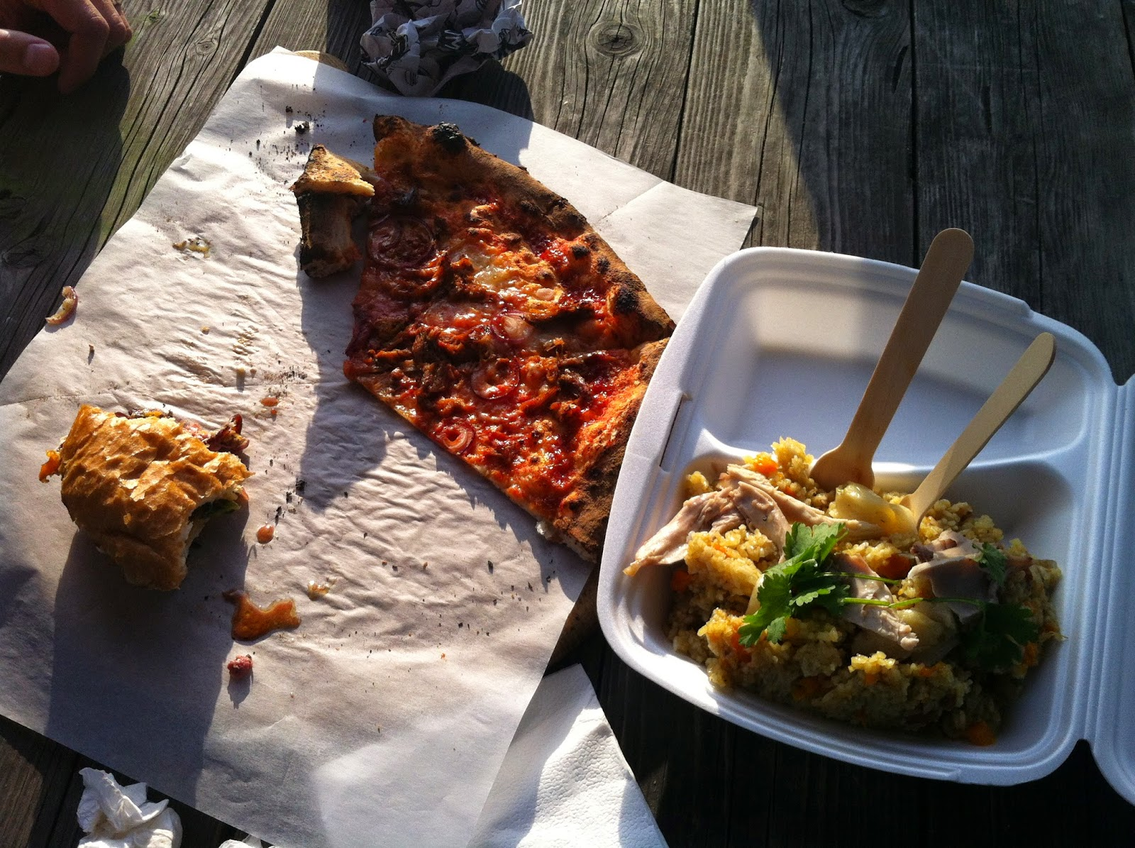Pizza, burger, and Uzbekistan rice from Open Kitchen in Vilnius.