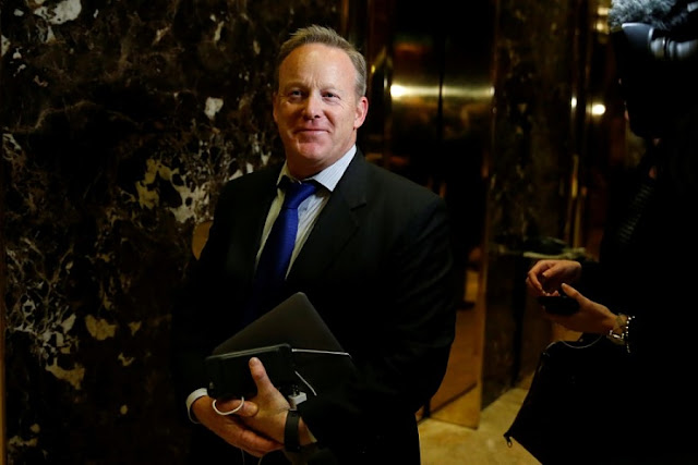 FILE PHOTO - Sean Spicer arrives in the lobby of Republican president-elect Donald Trump's Trump Tower in New York, New York, U.S. November 14, 2016.  REUTERS/Carlo Allegri