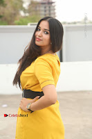 Actress Poojitha Stills in Yellow Short Dress at Darshakudu Movie Teaser Launch .COM 0298.JPG
