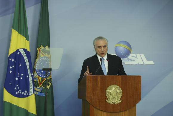 O presidente Michel Temer faz pronunciamento após aprovação do relatório que desautoriza o STF a investigá-lo Valter Campanato/Agência Brasil