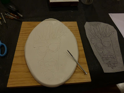 tracing traced aku aku onto clay