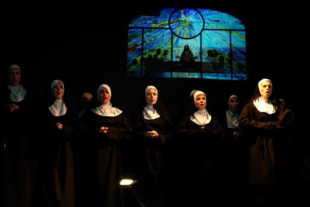 A long shot showing lots of the nuns in costume