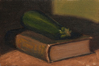 Oil painting of a green zucchini on a green linen-bound book.