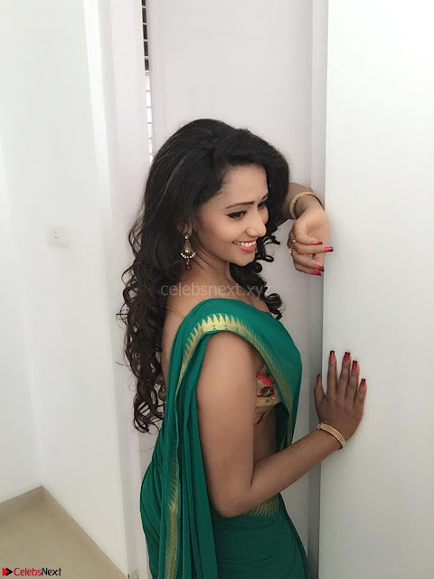 Sanjana Singh Looks Super cute in Green Saree Sleeveless Choli 2.JPG