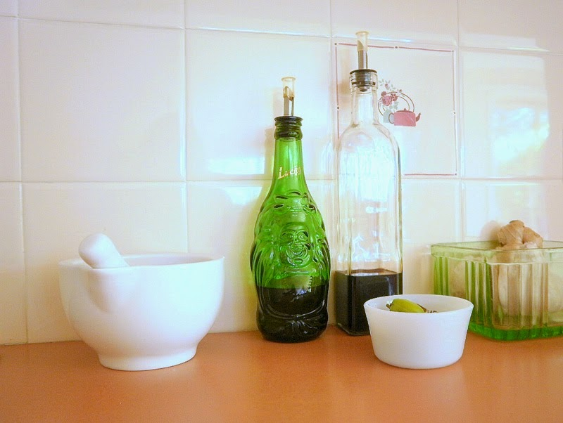 Upcycled beer bottle used an olive oil bottle