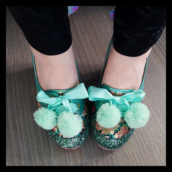 wearing irregular choice snuggle bunnie pom  pom detail