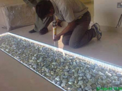 Diy river stone floor do it yourself ideas and projects for Pebble rock flooring diy