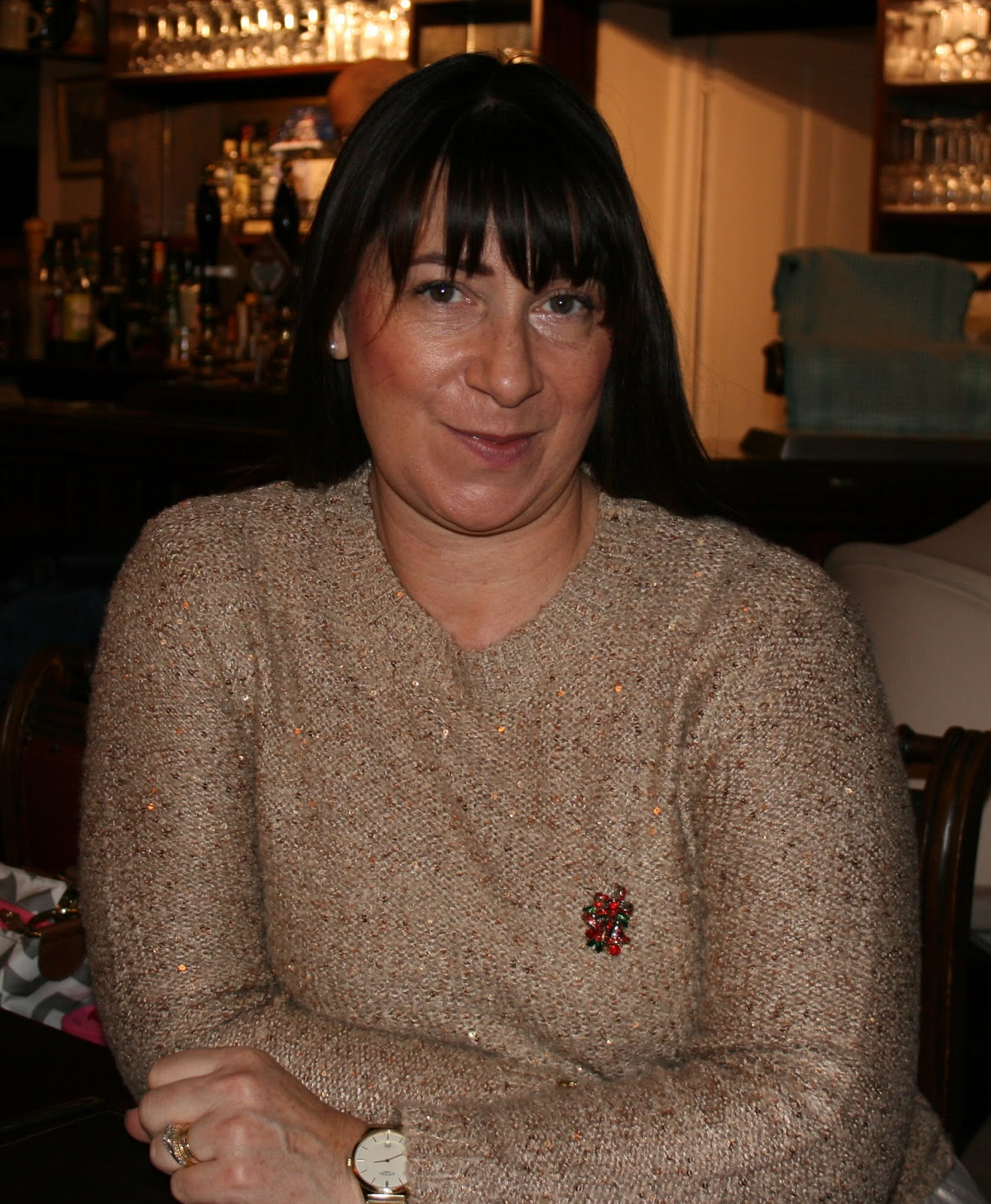 Image showing over 50s blogger Jacqui Berry in gold sequinned jumper for Christmas
