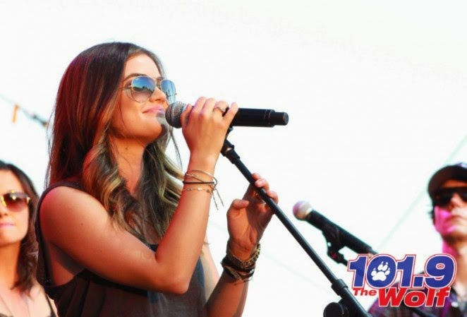 Lucy Hale performs in a plaid skirt at the 2014 Wolf Fest in Sacramento