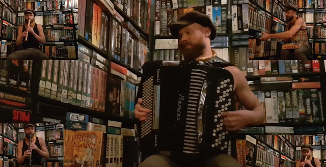 Screencap of music video with Yffisch playing several instruments