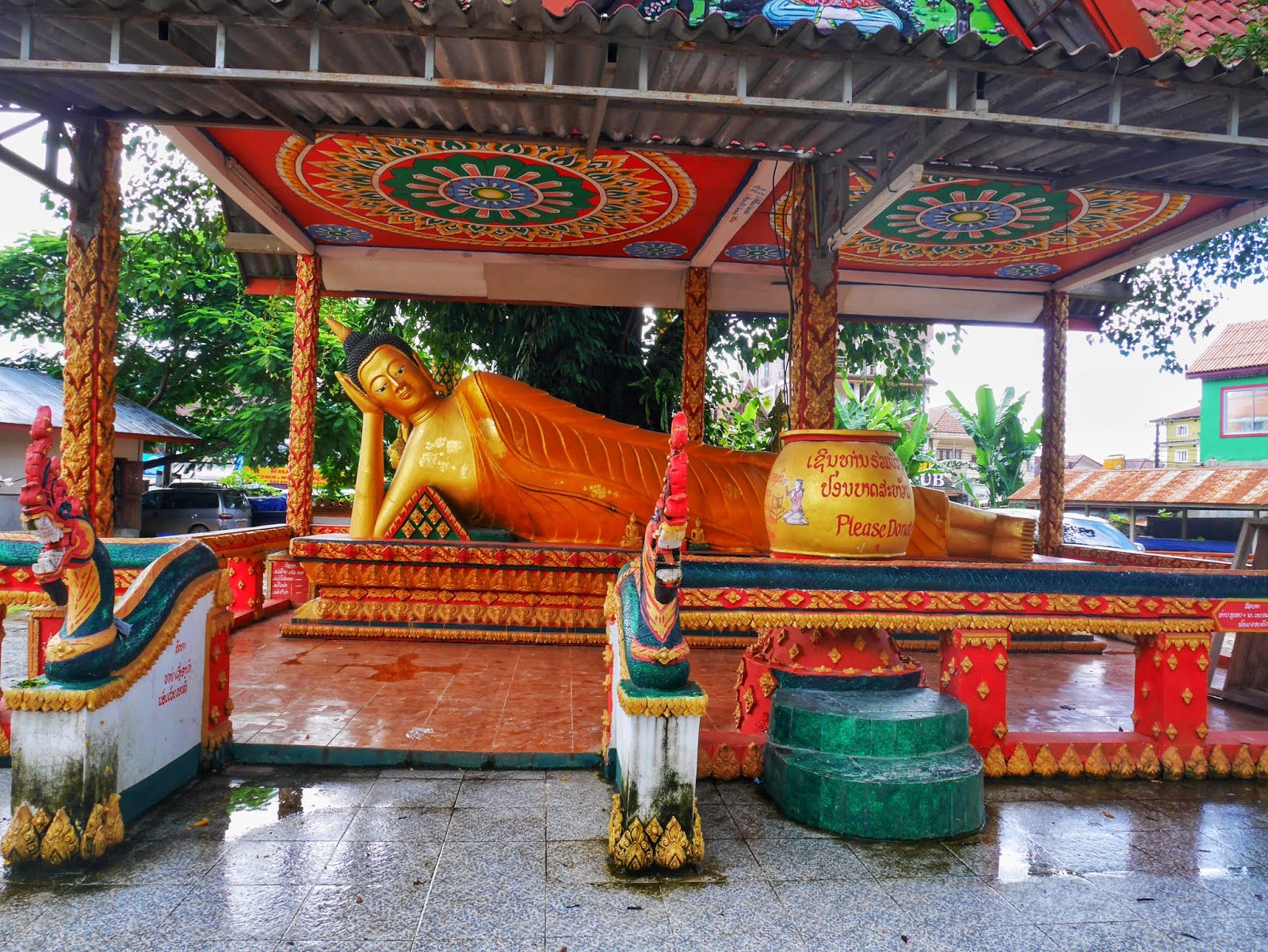 a reclining Buddha statue at a Buddhist temple in Vang Vieng, Laos