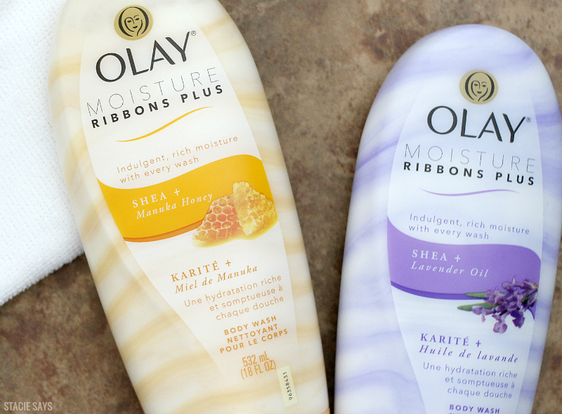 Olay Ribbons body wash on a brown marble tile