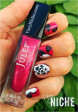 Finger Nail Art Design Step 6: large white and grey flower across three nails of the pinky, ring, and middle fingers with fuschia background. Dark Charcoal Grey leaves added to index, middle, and pinky fingers beside the flower.