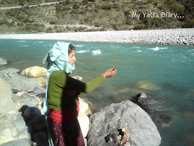 A woman shows the power of faith in Harsil, Garhwal Himalayas