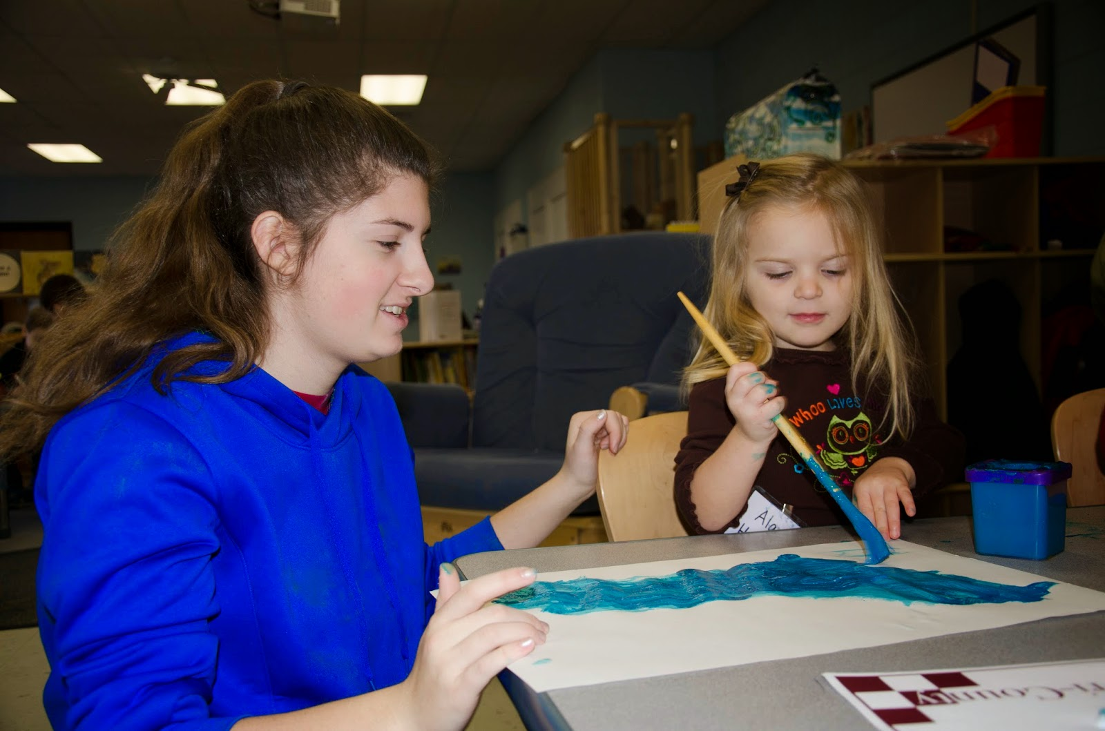 High school junior Corrinne Lombardi, of Wrentham, works with  a preschooler in the Tri-County Children's Center