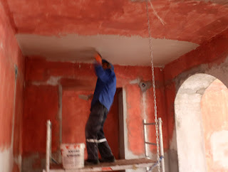 Sally starts to plaster the ceiling in the dining room