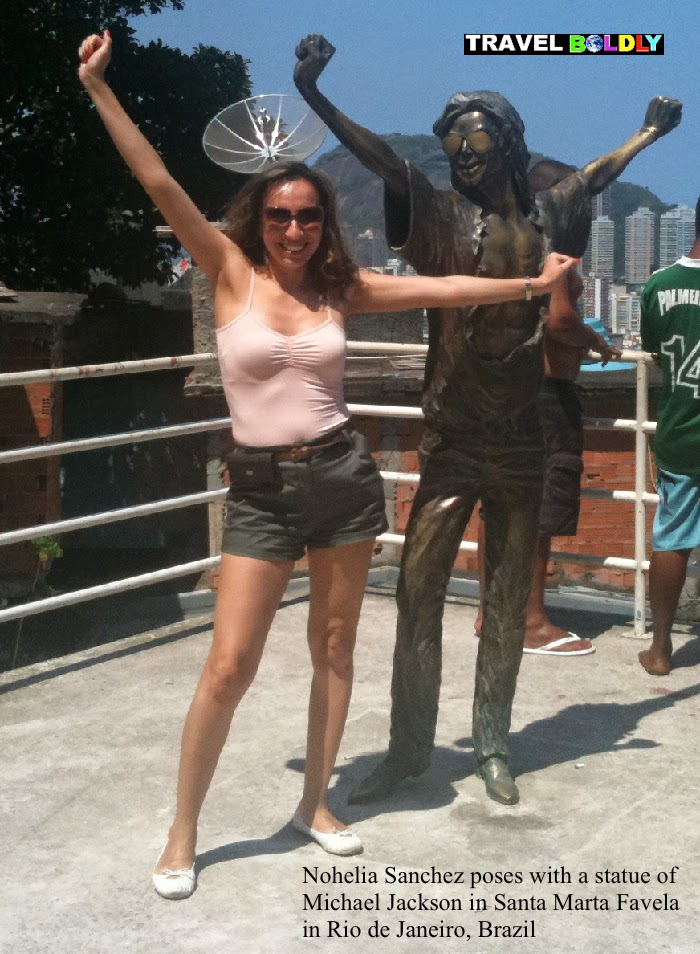 Nohelia Sanchez poses with a statue of Michael Jackson in Santa Marta Favela in Rio de Janeiro, Brazil. Photo copyright Nohelia Sanchez / www.rdj4u.com for www.TravelBoldly.com