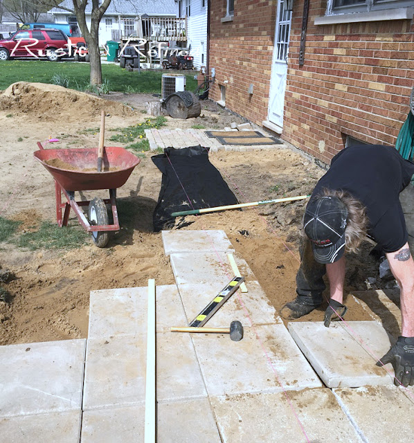 Adding large concrete pavers for a diy sidewalk project