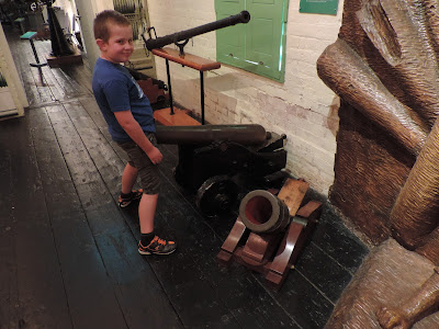 boy with his penis in a naval cannon