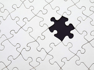 Picture of a jigsaw puzzle with a missing jigsaw piece
