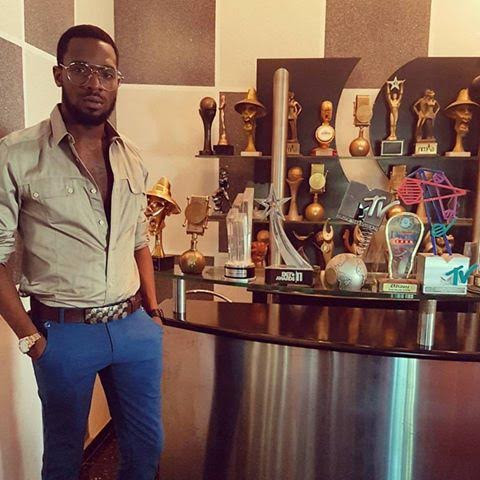 Dbanj thanks God as he poses besides all his awards