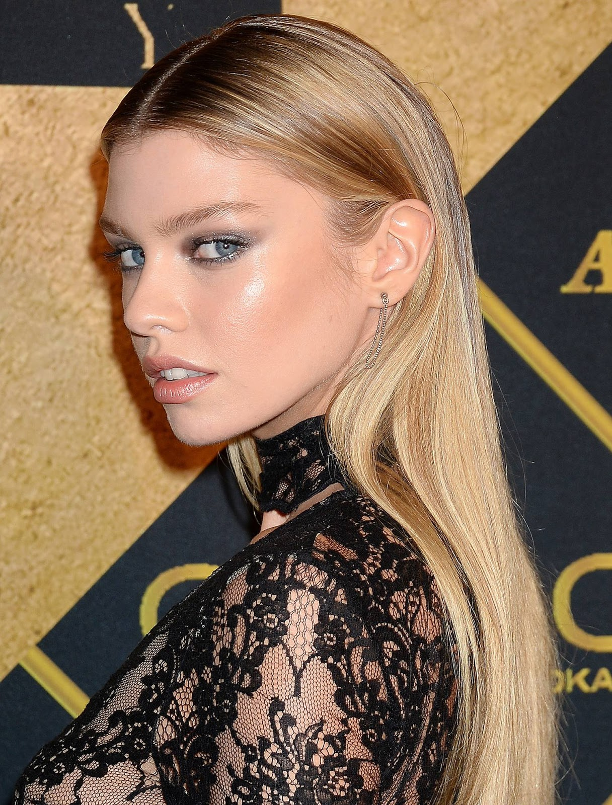 Stella Maxwell wears a racy black gown to the 2016 Maxim Hot 100 party in LA