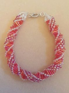 A Russian Spiral Bracelet , using pink bugle beads