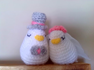 Crochet amigurumi Love Birds on top of empty Photo Frame