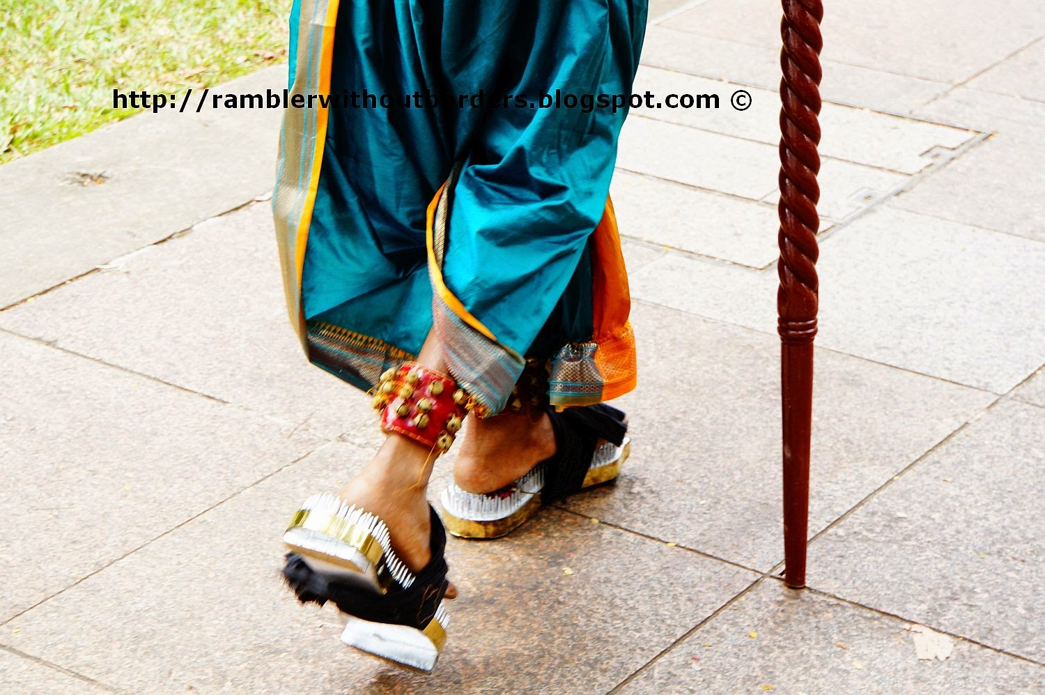 Devotee wearing sandals with metal spikes during Thaipusam Festival, Singapore