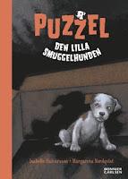 Omslag till Puzzel, den lilla smuggelhunden. Valpen sitter ensam i en kartong, omgiven av skuggor.