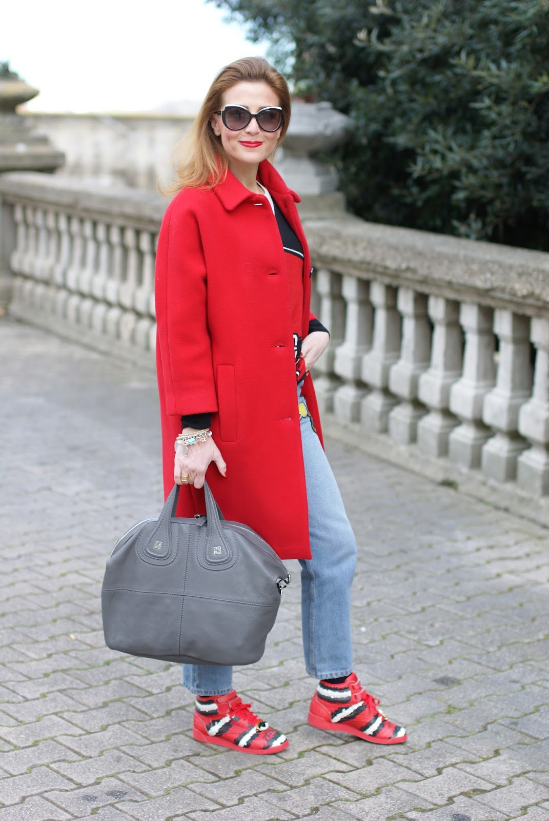 Casual transitional spring outfit with Reebok Classic Freestyle HI Melody Ehsani sneakers, red coat and grey Nightingale bag on Fashion and Cookies fashion blog, fashion blogger style