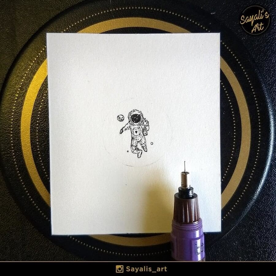 10-Tiny-Astronaut-Sayali-Horambe-Stippling-Fantasy-Art-Drawings-www-designstack-co