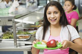 Girl leaving school lunch line.