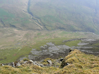 The view down from the top of the north east buttress of Lonscale Fell/></a></div> <div align=