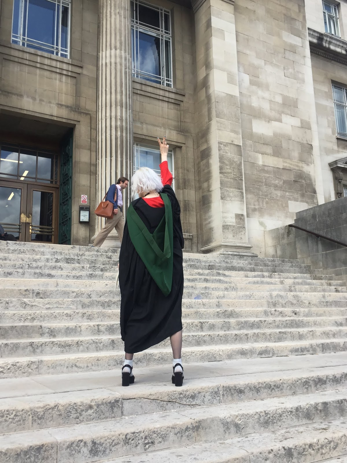 University of Leeds graduate on Parkinson steps making a V sign