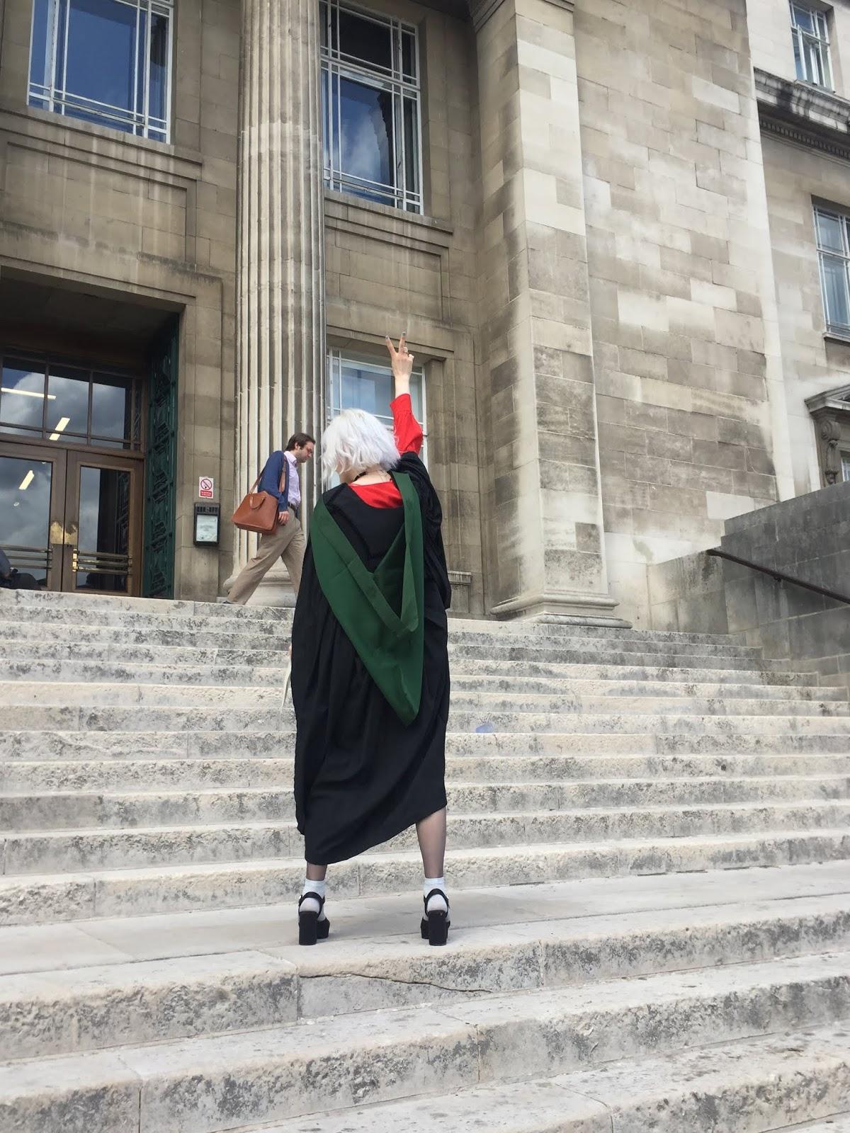 University of Leeds graduate on Parkinson steps making a V sign