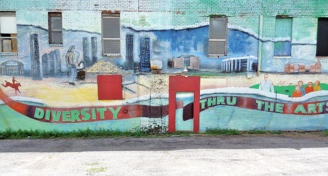 Panoramic View of Diversity thru the Arts mural on the North-facing wall of the Midtown Arts Center