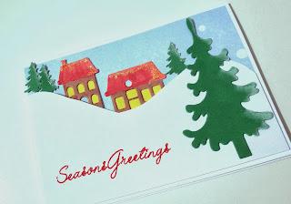 Die cut winter scene Christmas card with peel off greeting