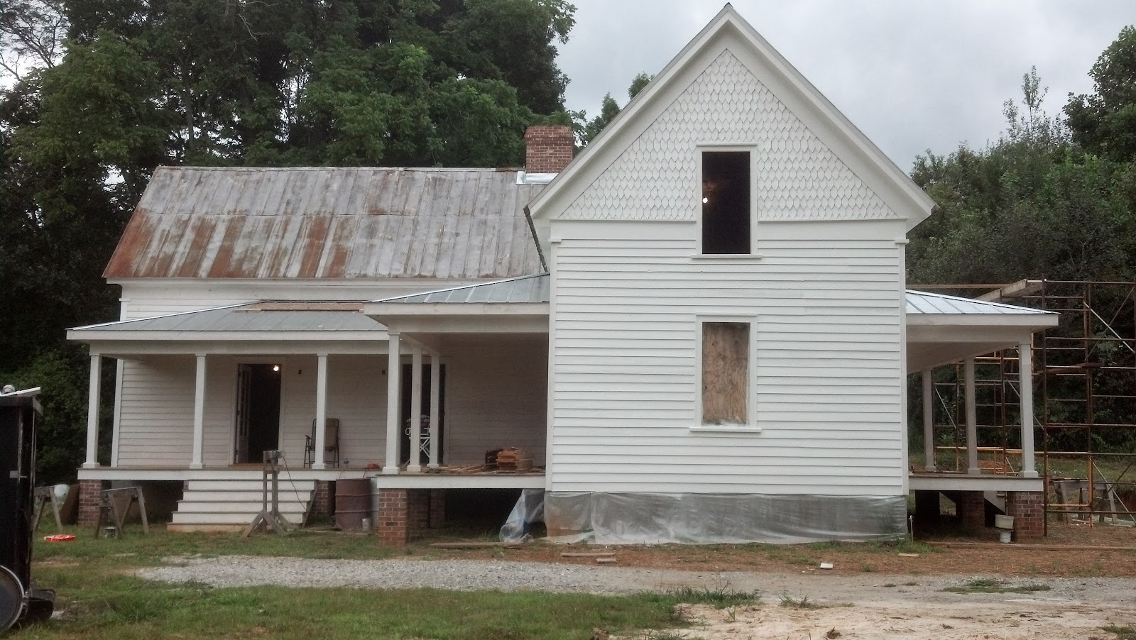 The Ledford Colley House A White Farmhouse With A Metal