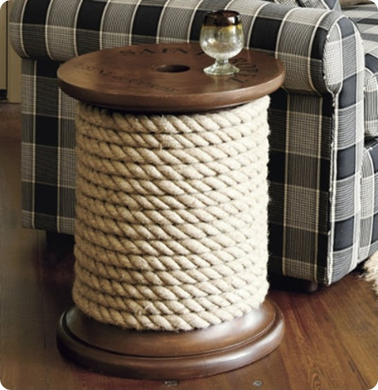 This giant thread spool side table is life-sized and perfect for the living room