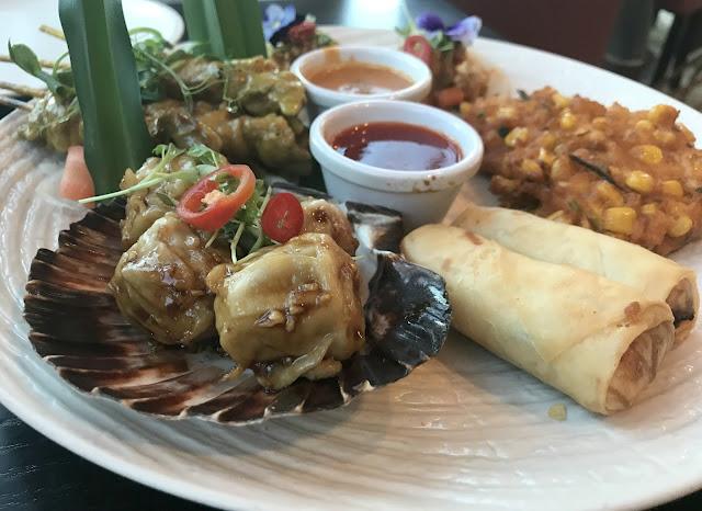 sharing starter platter, pork dumplings, spring rolls, satay chicken