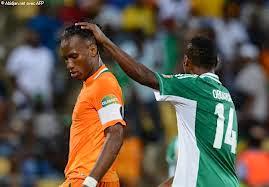 Drogba and Oboabona during Nigeria vs Ivory coast